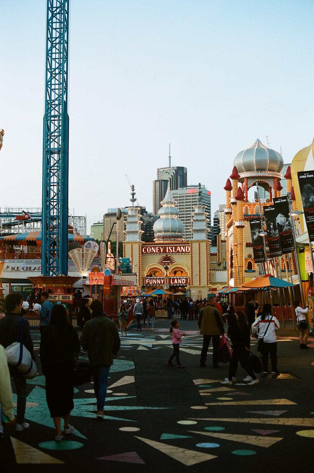 people walking near amusement park during daytime