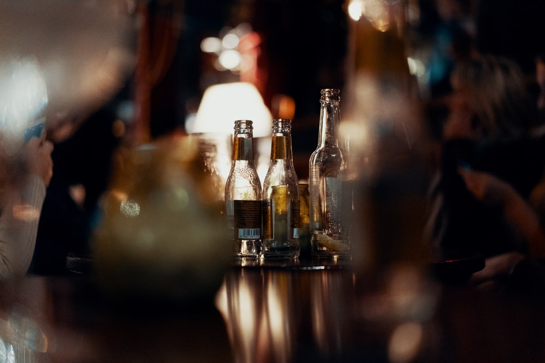 Bottles On A Table In A Bar - unsplash