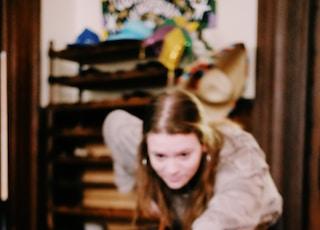 selective focus photo of woman playing pool