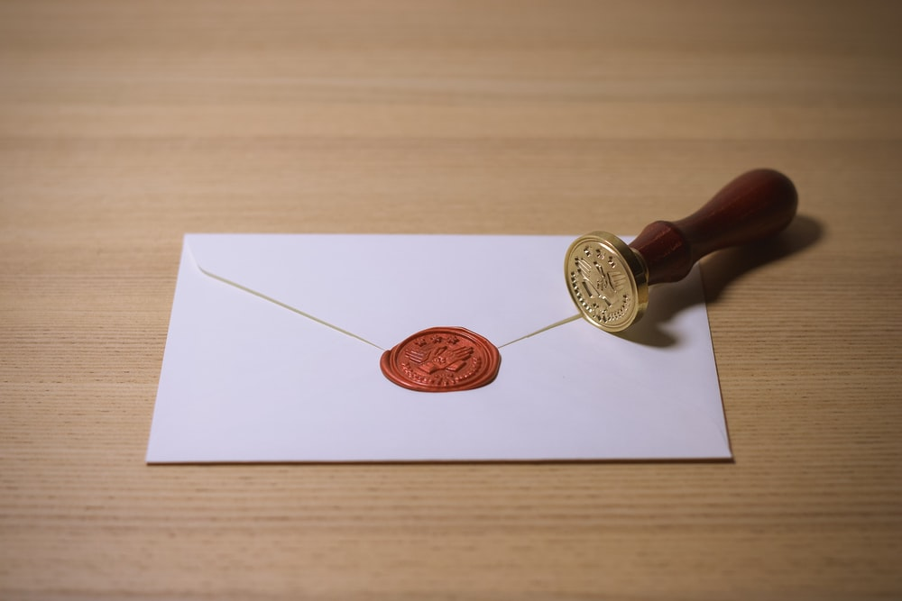 white envelope with brown stamp