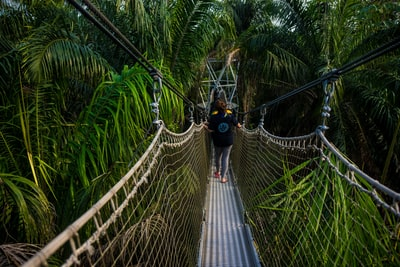 unknown person walking on hanging bridge nigeria teams background