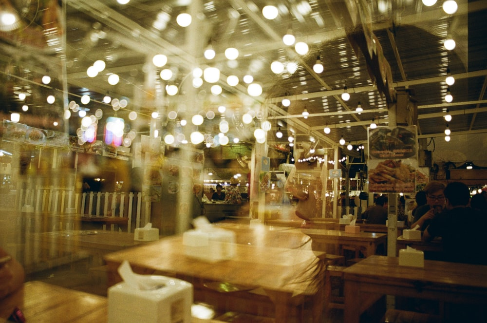 people gathering on restaurant with lights