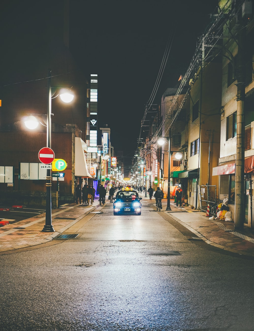 a car passing by a street in the city during nighttime