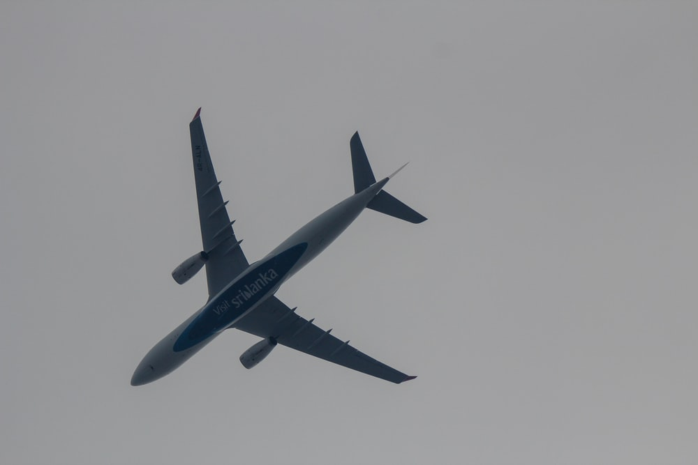 white flying airline
