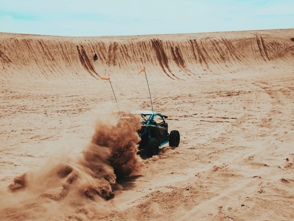 time-lapse photography of a UTV passing a rough road