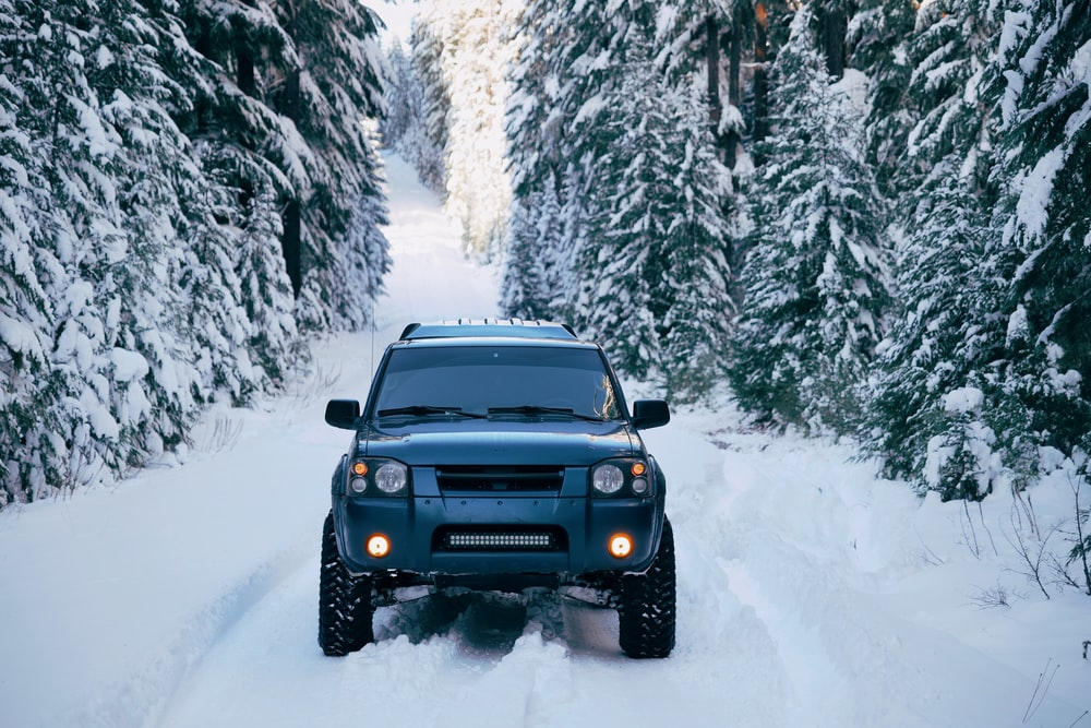 black SUV on snow-covered road