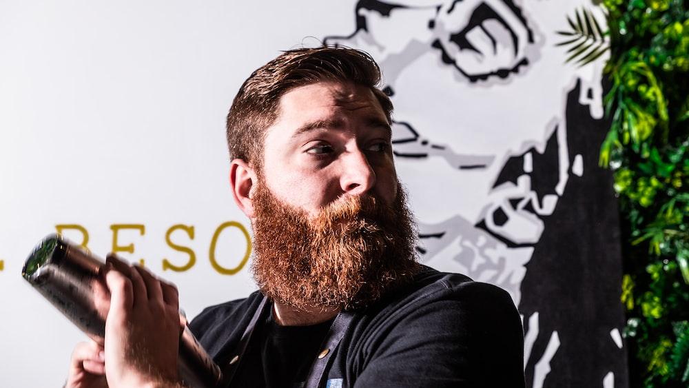 man holding hair dryer