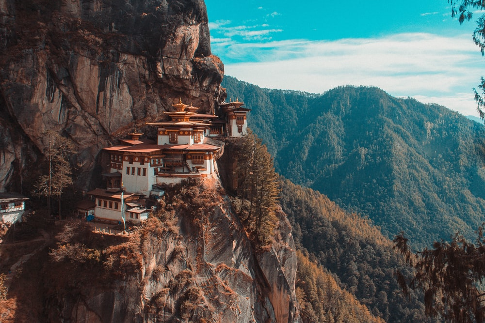 Paro Taktsang temple in Bhutan viewing mountain under blue and white sky