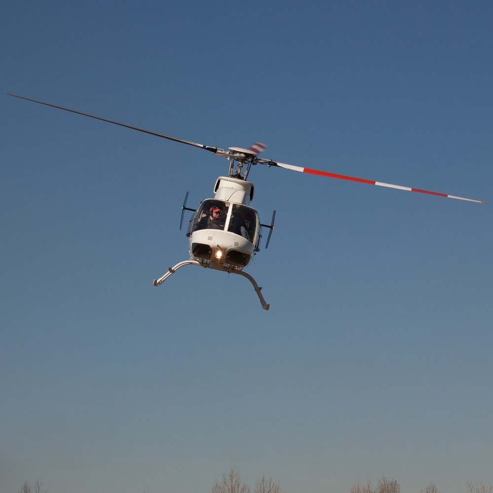 helicopter in mid air during day