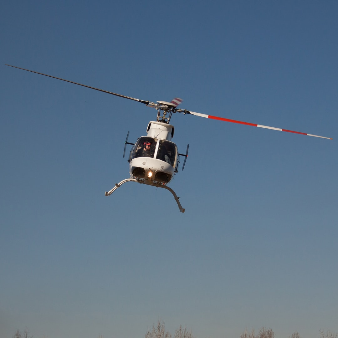Frontal view of Bell 407 helicopter taking off