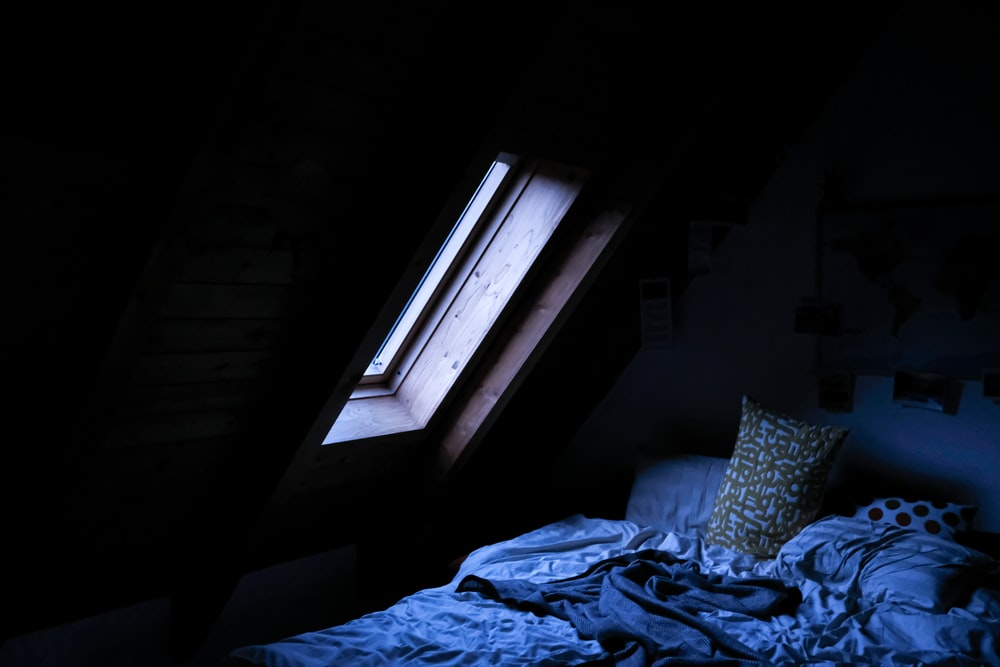 bed near window during day