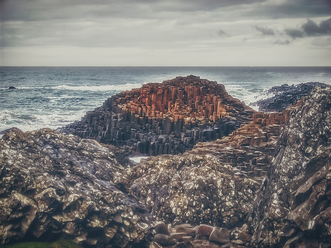 Looking out into the North Atlantic from the Giant's Causeway. The causeway (land bridge) is formed from hexagonal shaped volcanic rock pushed to the surface at high pressure.