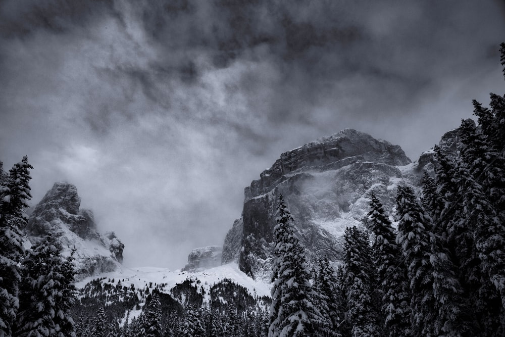 grayscale photography of summit view of mountain covered with snow
