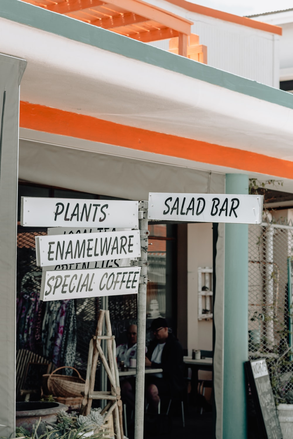 plants, enamelware, special coffee, and salad bar signage