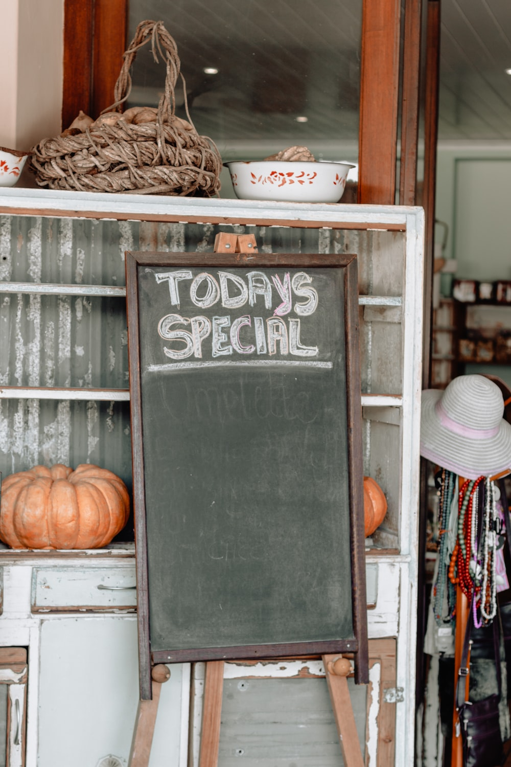 green chalkboard with brown frame