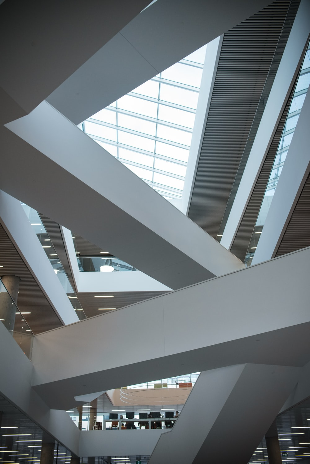 white painted building interior with clear glass ceiling
