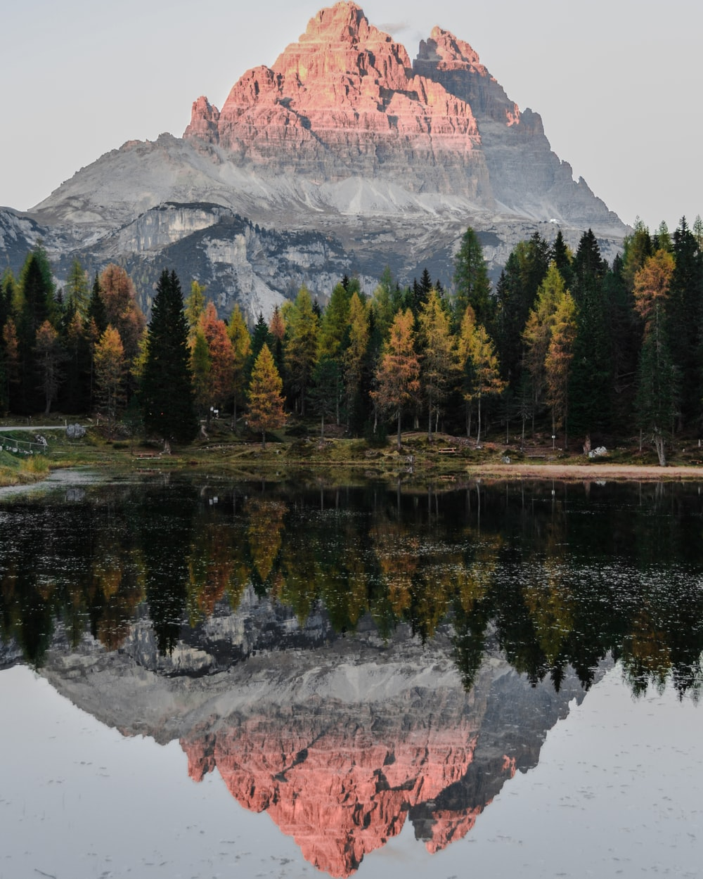 water reflect photography of mountain ridge