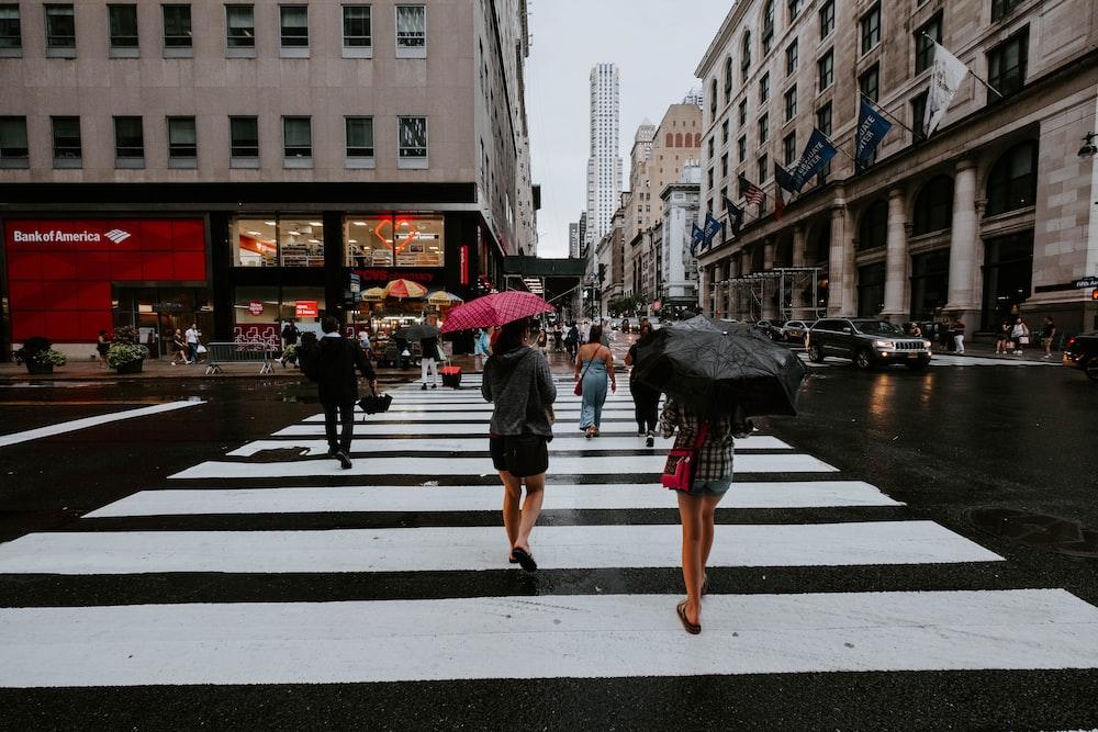 people crossing on pedestrian