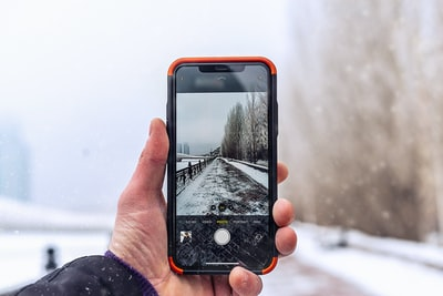 black Android smartphone capturing road