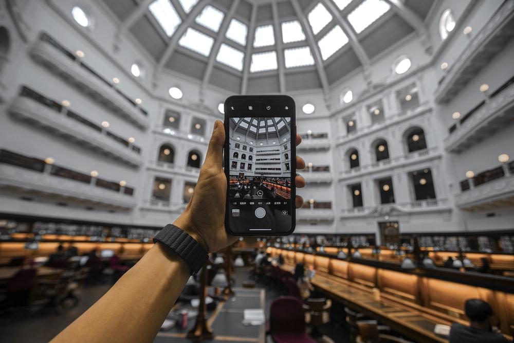 smartphone capturing building interior