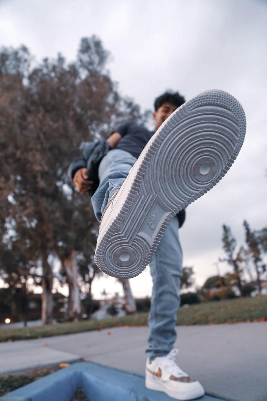 man showing his sneaker