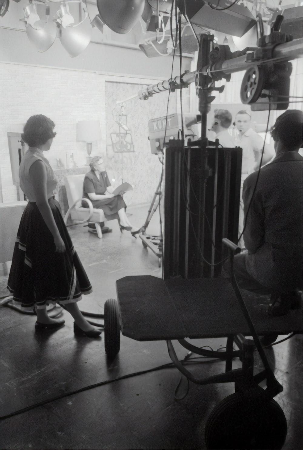 grayscale photography of people inside studio