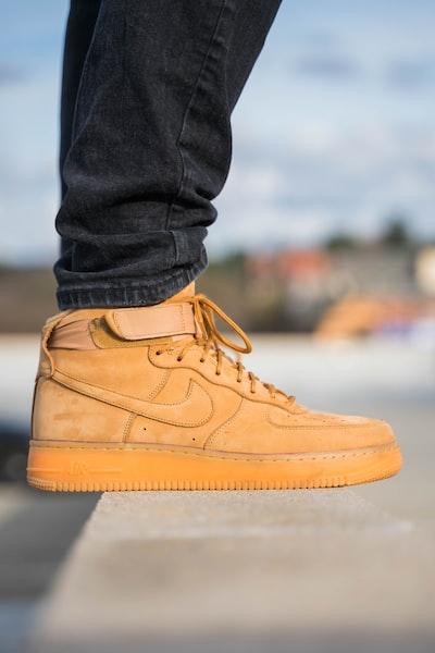 pair of brown Nike Air Force 1 high