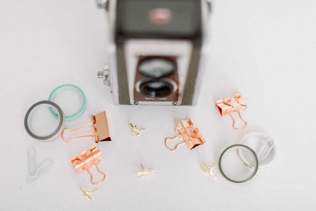 Vintage Camera With Various Office Supplies - unsplash