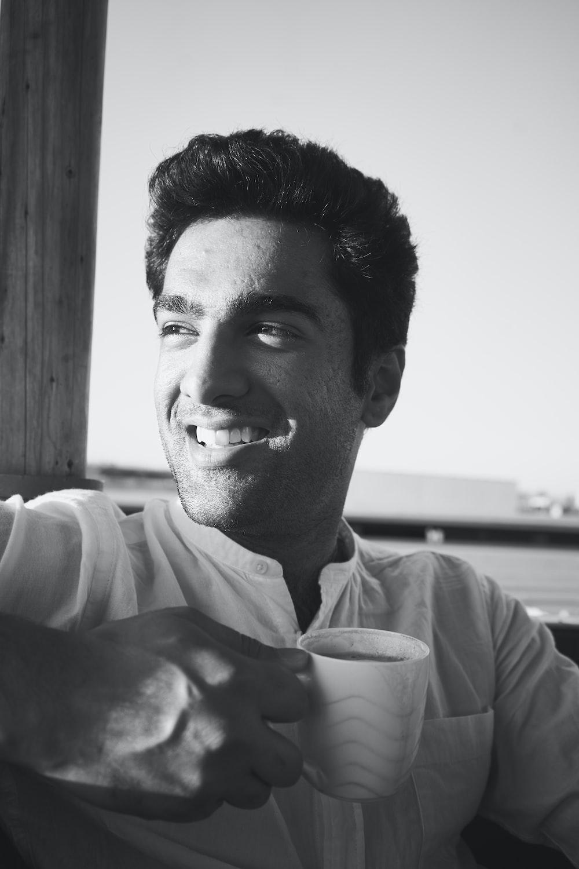 smiling man holding mug