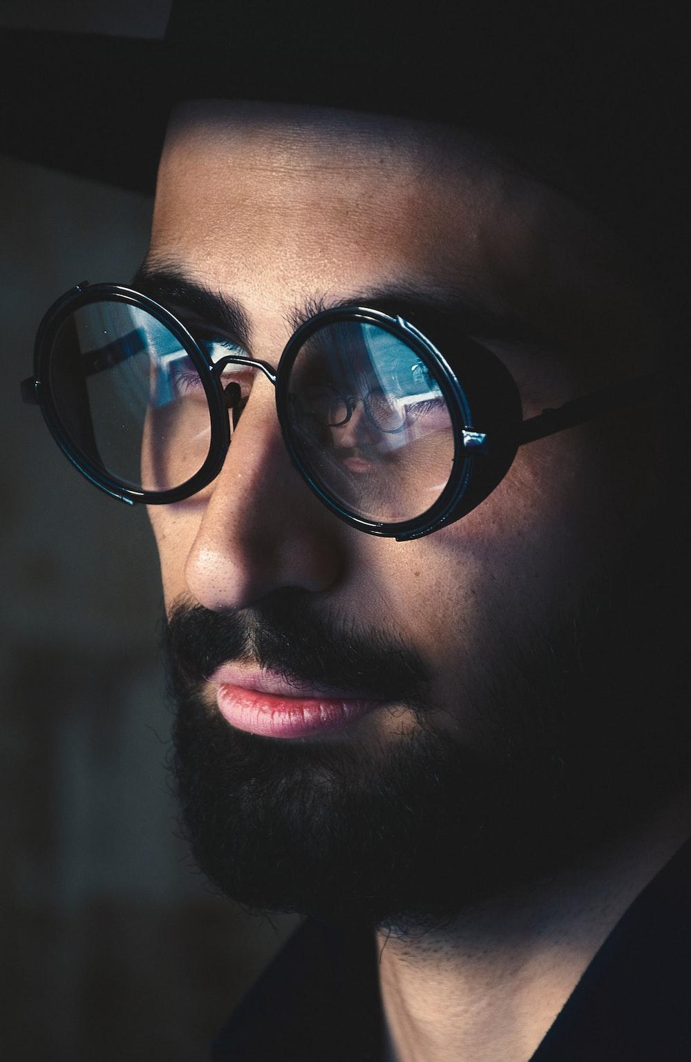 selective focus photography of man wearing black framed eyeglasses
