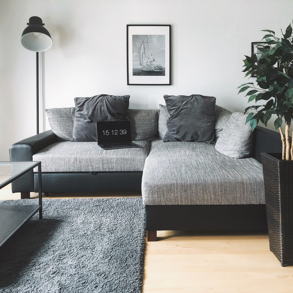 laptop on sectional sofa