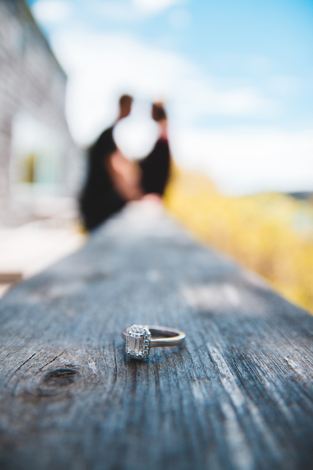 gold-colored ring on wooden fence