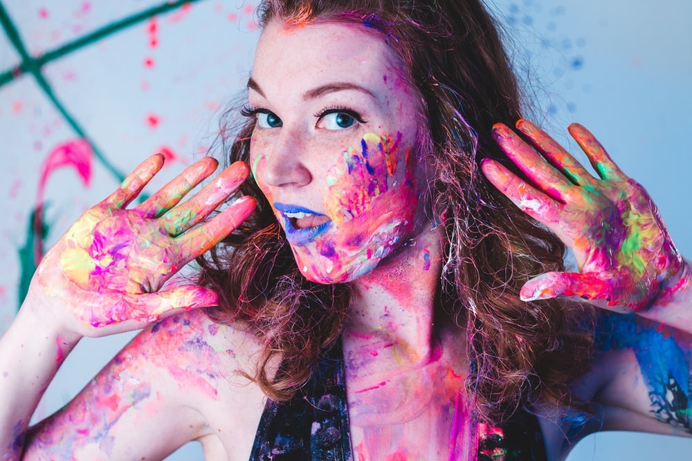 woman full of paints on hands