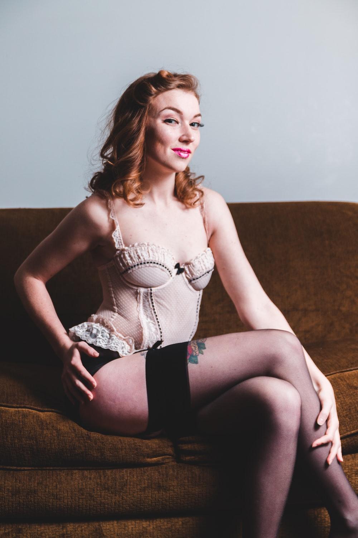 woman sitting on sofa wearing lingerie