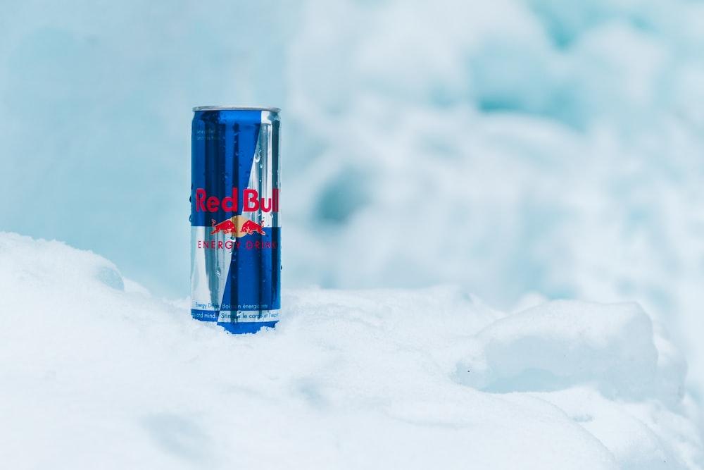 Red Bull energy drink on white snow