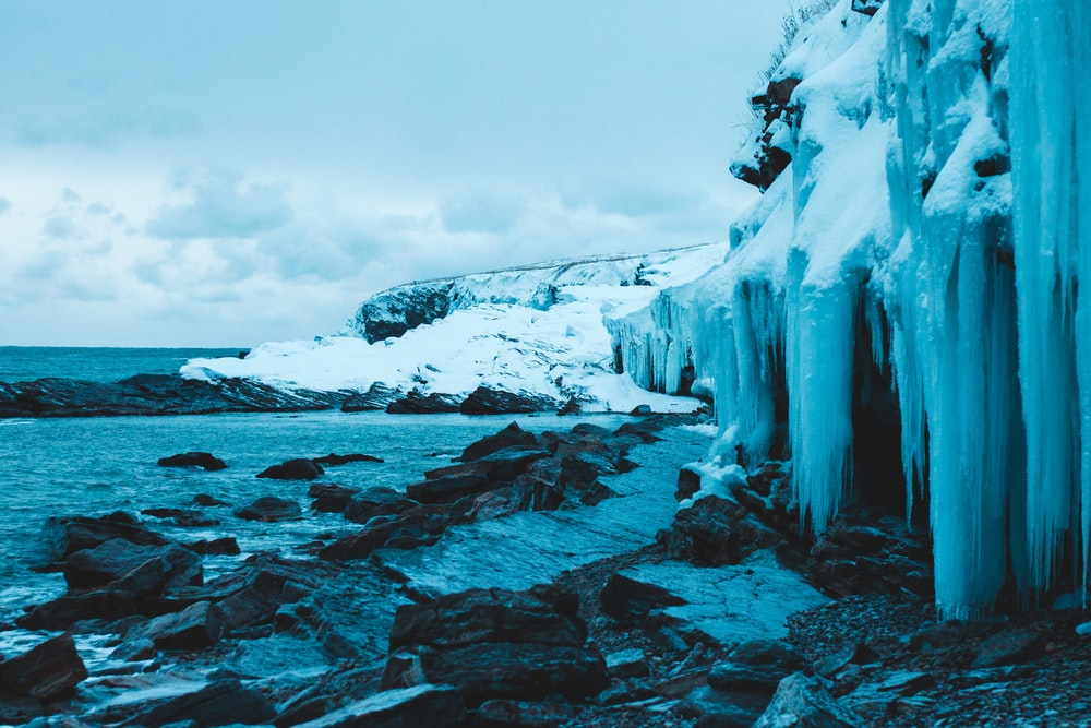 ice-covered rock formations near seashore