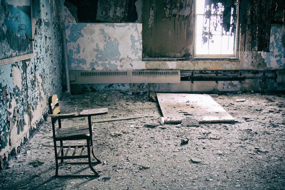 brown wooden armchair inside room