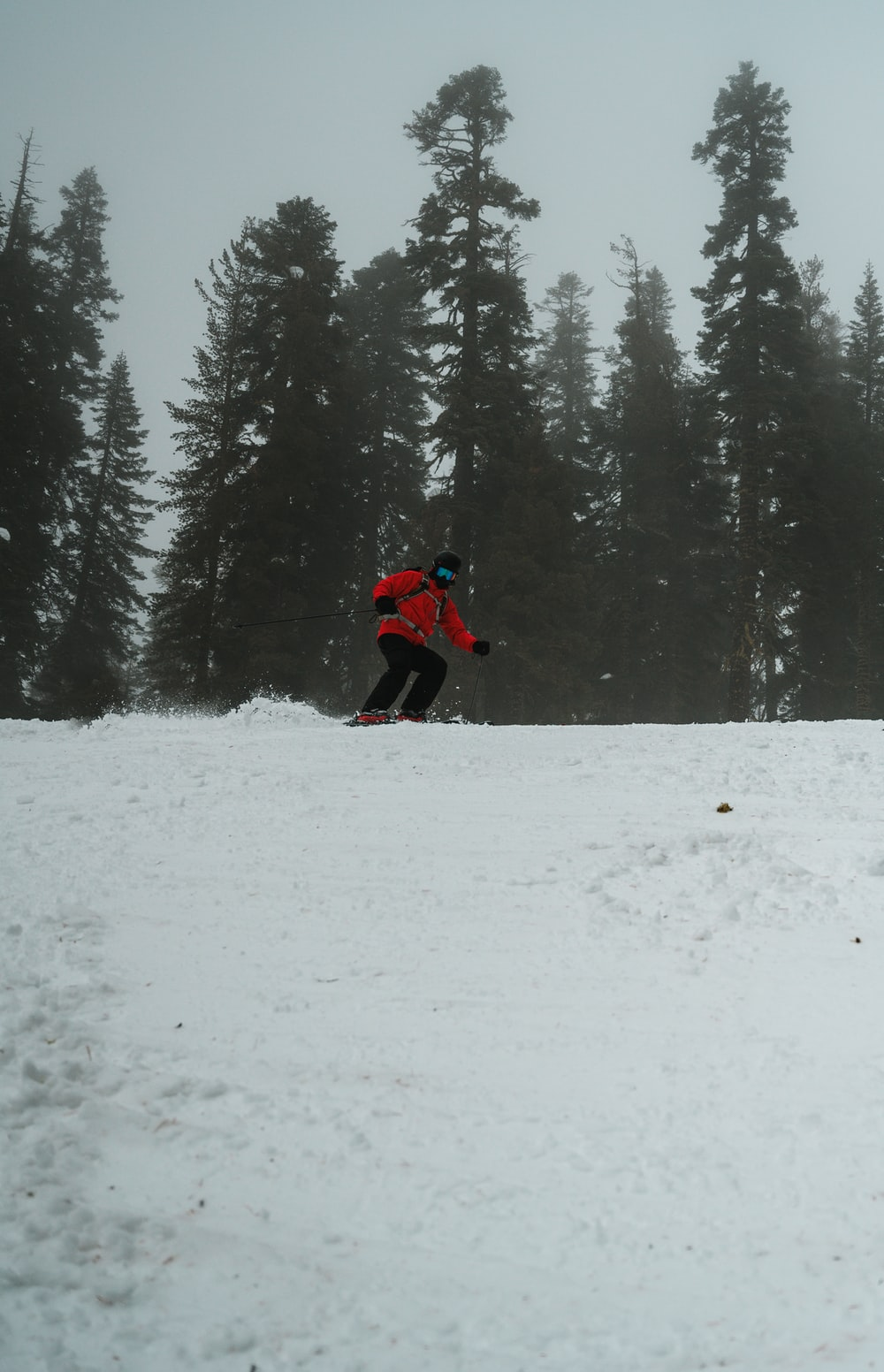 man skiing on hill covered with ice