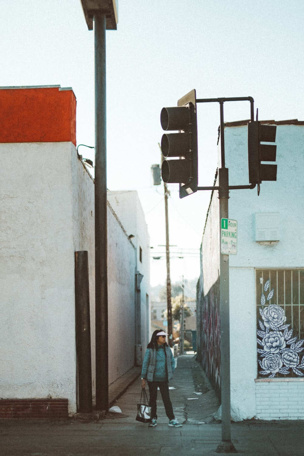 woman standing near building during daytime
