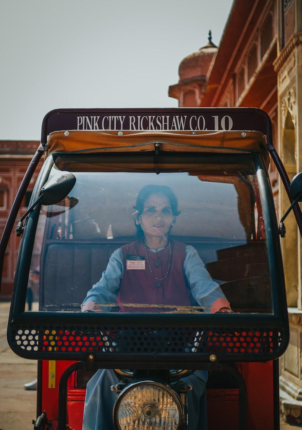 person riding auto rickshaw during daytime