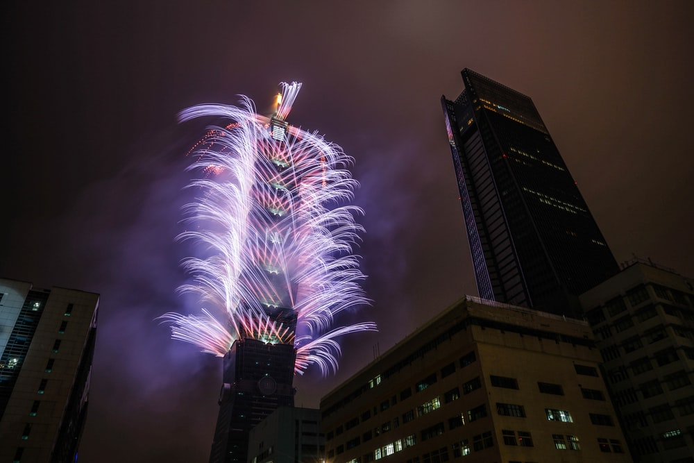 photography of fireworks on building during nighttime