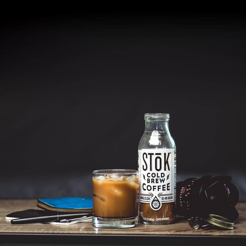 Stok cold brew coffee bottle and drinking glass