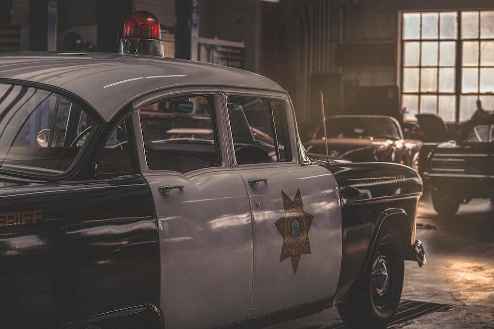 white and black Sheriff vehicle