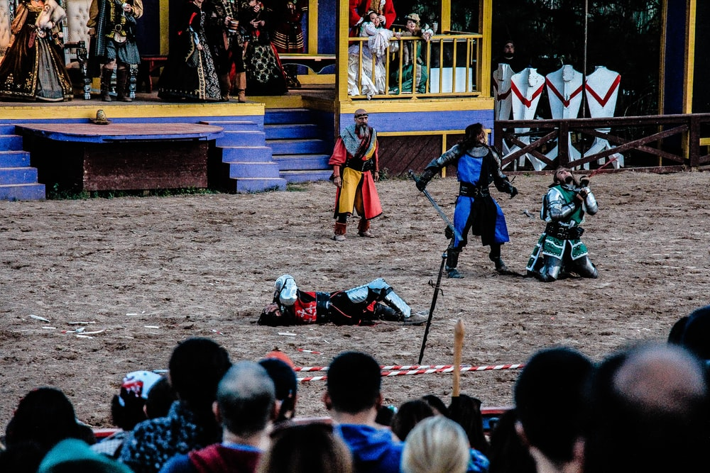 people playing historical play on field