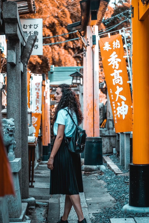 woman stands near tori gates