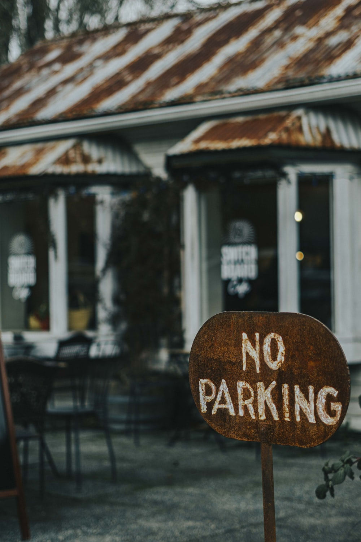 brown No Parking metal signage