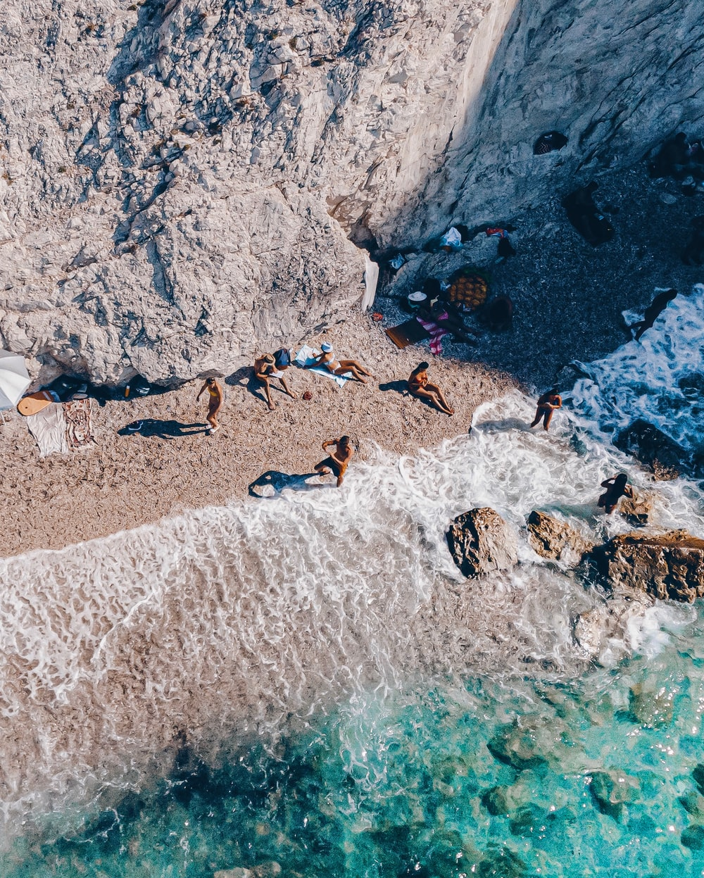 aerial photography of people on seashore during daytime