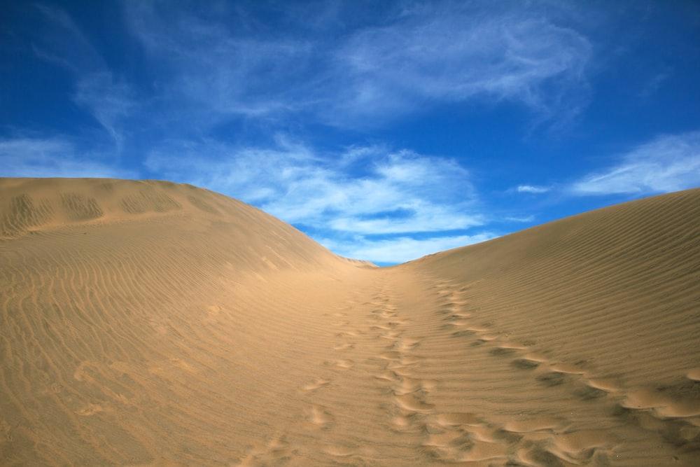 sand dunes under blue sky