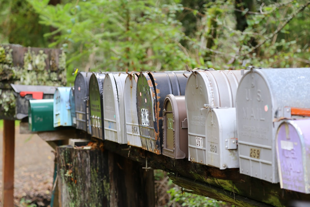 selective focus photography of gray mail boxes during daytime