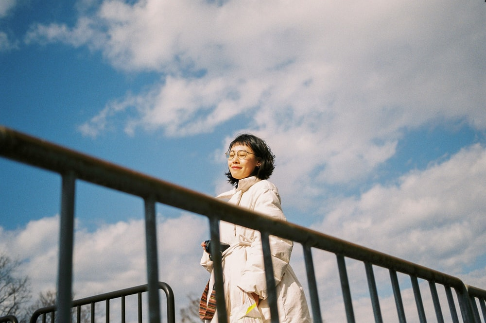 shallow focus photo of woman in coat